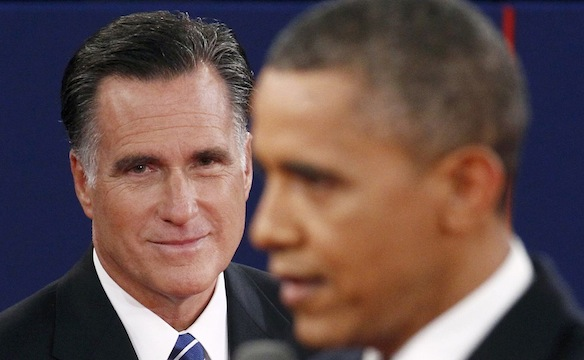 Republican presidential nominee Romney listens as U.S. President Obama answers a question during the second U.S. presidential campaign debate in Hempstead, New York